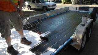Iron Armor Bed Liner painted on wood trailer