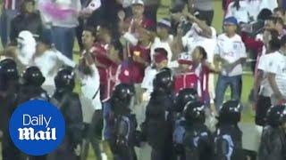 Fans goad each other as violence breaks out before Honduras match