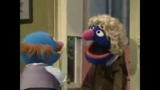 Sesame Street - Grover sells wigs to Mr. Johnson