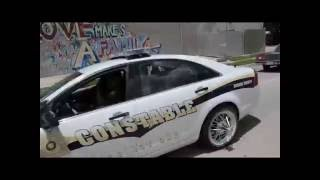 Paul Wall Swangin in the Rain (Paul Wall and friends ride with deck out Police car)