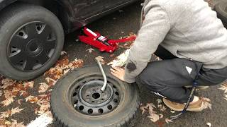 How to Change a Tire (plus jacking it up)--Changing snow tires/wheels on my Jetta