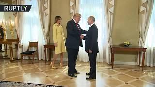 بوتين وترامب يتصافحان قبيل قمتهما في هلسنكي