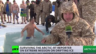 Russian troops plunge into icy water near North Pole during Arctic drill