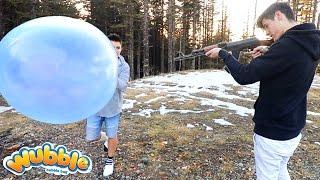 EXPERIMENT GUN VS WUBBLE BUBBLE (WILL IT POP?)   David Vlas
