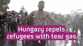 Refugee crisis: Hungary uses water cannon as people head to Serbian border