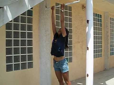 Small Thai Girl does chin ups 22 years old