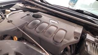 How to unlock the factory style transmission dipstick check and properly add fluid on a 2010 Nissan