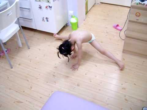 Little girl doing stretching .