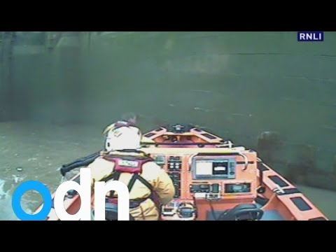 Dramatic moment unconscious woman is rescued from River Thames