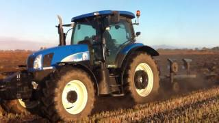 New Holland TS-A 135 & 4f ploughing rice field