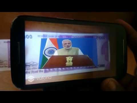 Modi speaking in 2000 rupees note