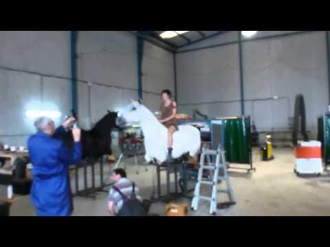 sexy girl on mechanical horse