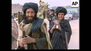 Afghan interim leader makes base in Mullah Omar's compound.