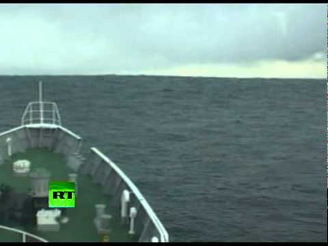 Tsunami Climbing Incredible video of ship heading into wave in Japan