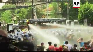 Riot police in Manila use water cannon at anti Trump protest