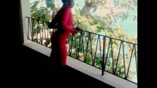 SEXY ASS JAMAICAN WOMAN BEING SEDUCTIVE SINGING A SONG