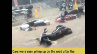 Dozens of vehicles swept away by torrential rainstorm that slams north China