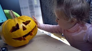 Cute Baby Meeting to Halloween Pumpkin for the first time