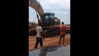 Excavator coming off a trailer in Ghana