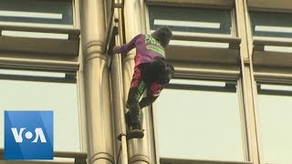 French Spiderman Climbs Hong Kong Building