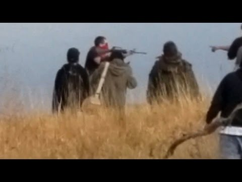 Download Did a DAPL Security Worker Wielding an AR-15 Rifle Try to Infiltrate Native Water Protectors? HD Mp4 3GP Video and MP3
