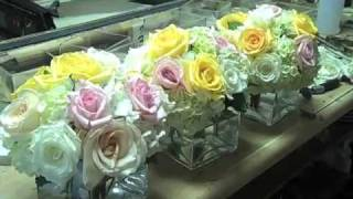 Designing cube vases with roses + hydrangeas.