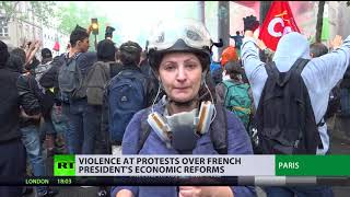 Police use tear gas, protesters throw stones as anti-Macron rally turns violent in Paris