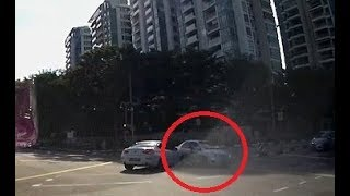 Bizarre moment car appears from nowhere at a busy junction to cause crash