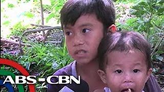 TV Patrol: Litrato ng batang pinagsasabay ang pag-aaral at pag-aalaga sa kapatid