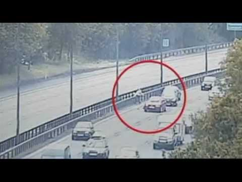 shocking footage two demented insane women run in front of oncoming traffic on motorway