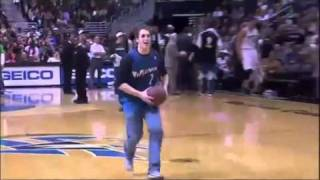 Fan makes a basketball dunk while he's on the phone
