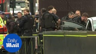 Armed police swoop to arrest man after cyclists hit in Westminster terror attack