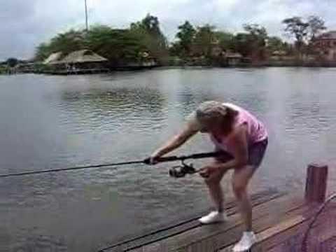 Lady landing a huge Giant Mekong Catfish