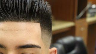 Slicked Back Pompadour with Bald Fade; pomp; scissor haircut; razor fade