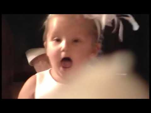 Funny flower girl yells down the aisle for the groom