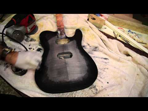 Black burst bursting a flame maple guitar with water based tints