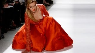 Model falls down during Dennis Basso Fall/Winter 2012 RTW fashion show