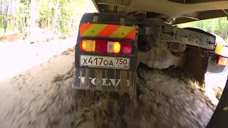 Volvo Trucks - Running footage of a Volvo FMX navigating through the mud-filled roads in Russia
