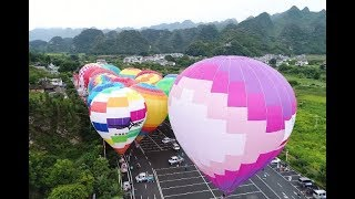 Colourful Hot Air Balloons Soaring Over Mountains in Southwest China