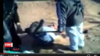 بالفيديو هام مايسمى بالجيش الحر يقوم بتعذيب المدنيين بطريقة وحشية
