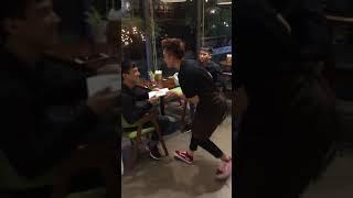 Funny Dancing Waiter in Restaurant