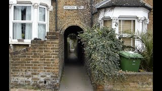 RARE Alley to a railway crossing in London