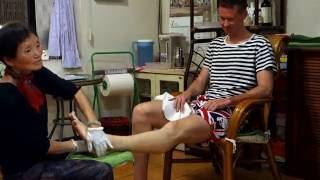 A strong man suffering from extreme pain during the real Chinese Massage