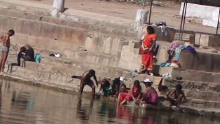 Holi bath in 7th Century Khajuraho Pond