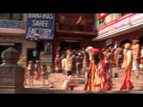 Naked Hindu holy men rallying towards Ganga Ghat in Varanasi for Maha Shivratri
