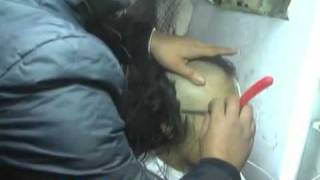 Asian Lady headshave to bald with a sharp knife in classic barber shop.flv