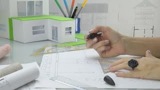 Woman Architect Draws Plans Stock Video