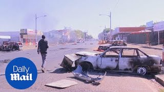 Cars are burned as rioting spreads through Johannesburg