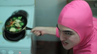 PINK GUY COOKS STIR FRY AND RAPS