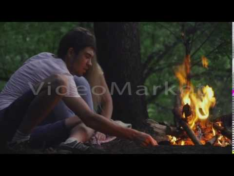 Xxx Mp4 Beautiful Young Couple Sitting Near A Campfire In The Forest 3gp Sex